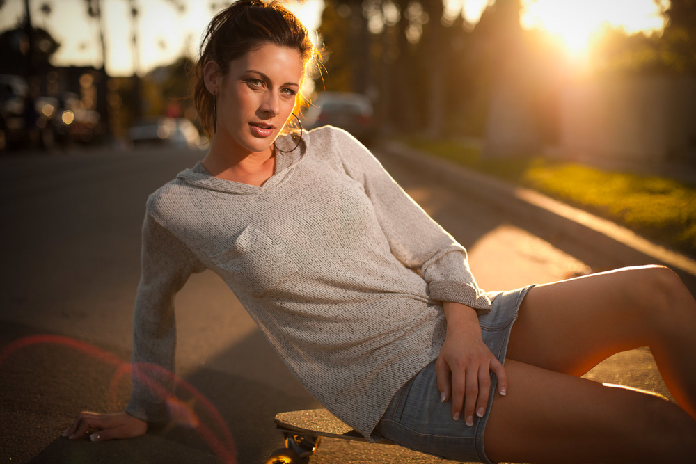 chick on skateboard sunlight.jpg