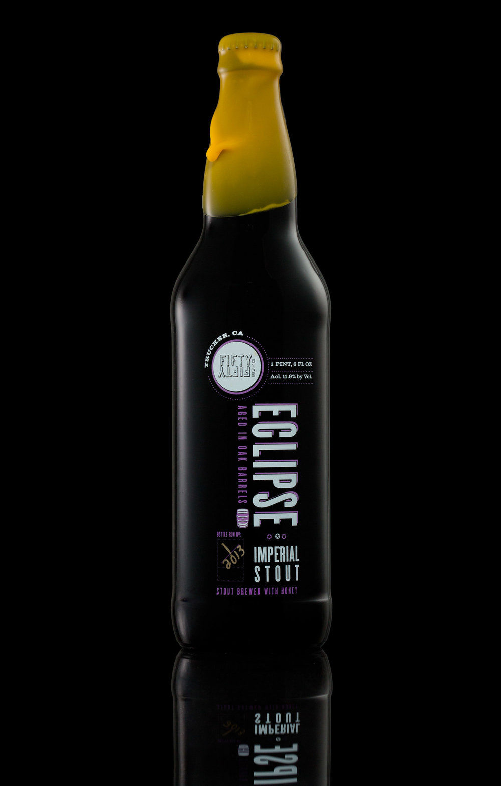 Eclipse Imperial Stout by Fifty Fifty Brewing, Truckee, CA. Bottle on black background.