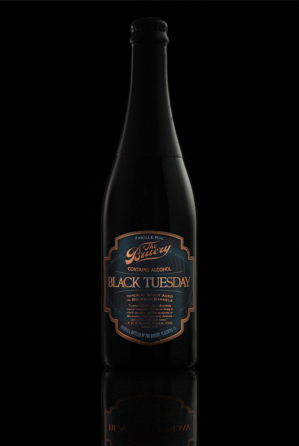 The Bruery Black Tuesday Bottle on black background. Craft beer.