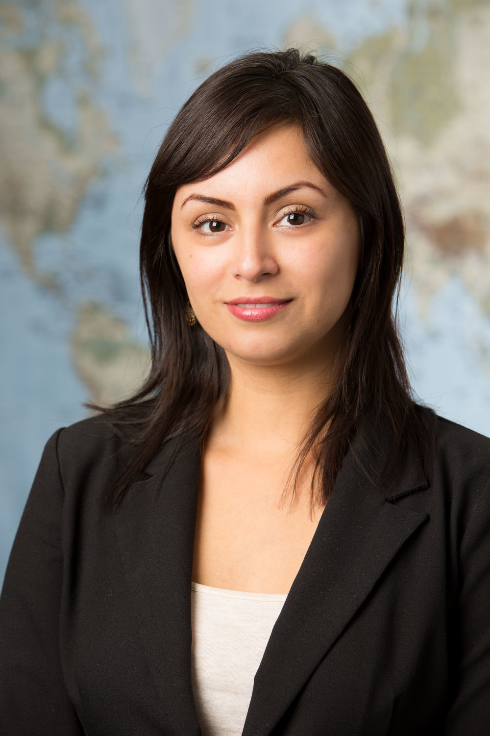 Corporate headshot of a young professional woman.