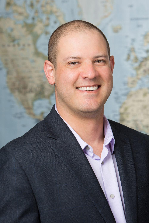 Headshot photo of a marketing manager.