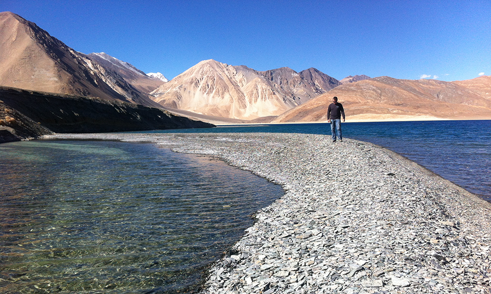 Brad-looking-for-Stones-to-skip-Pangong-2.png
