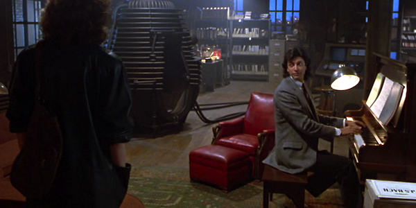 Jeff Goldblum plays the piano for Geena Davis in David Cronenberg's     The Fly