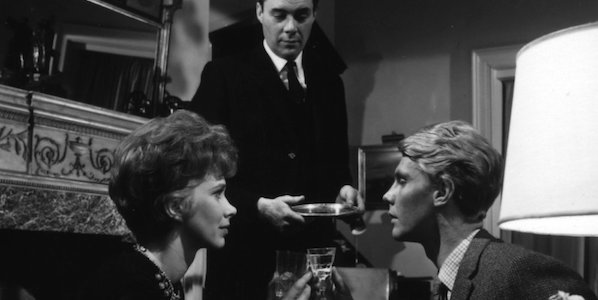 Dirk Bogarde, Wendy Craig and James Fox share a toast in Joseph Losey's The Servant