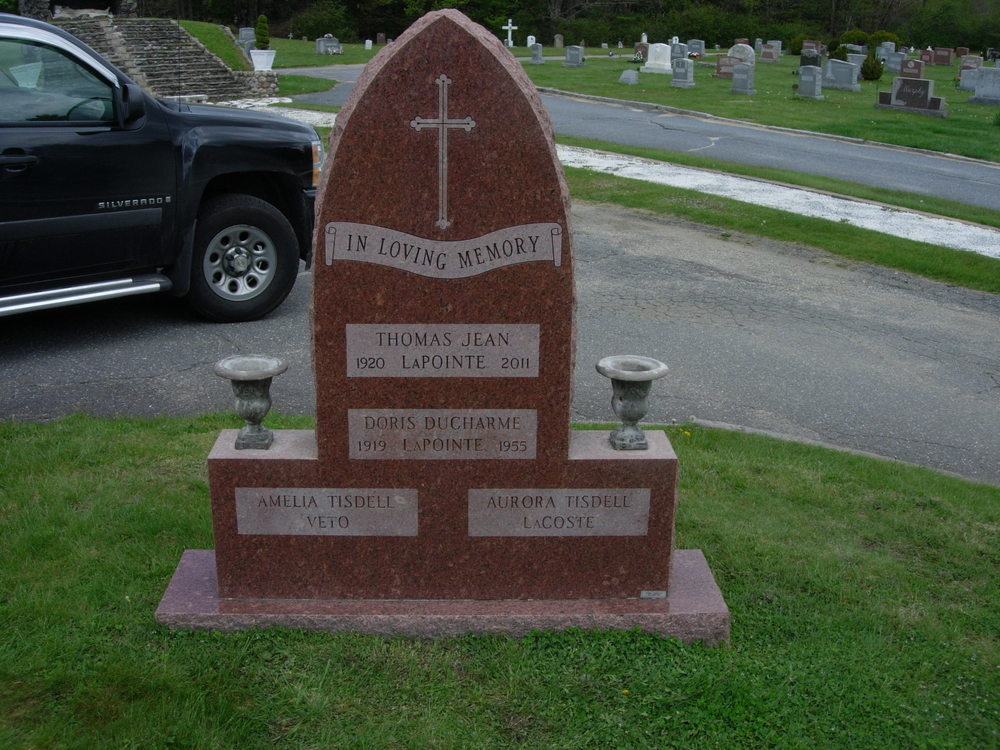 A scroll panel inscription and new name inscription with panel were added to the back of this monument to fill its space.