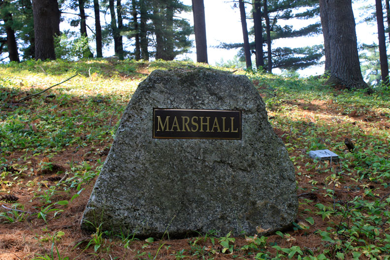 Bronze Family Name   Plaque  on a  boulder monument