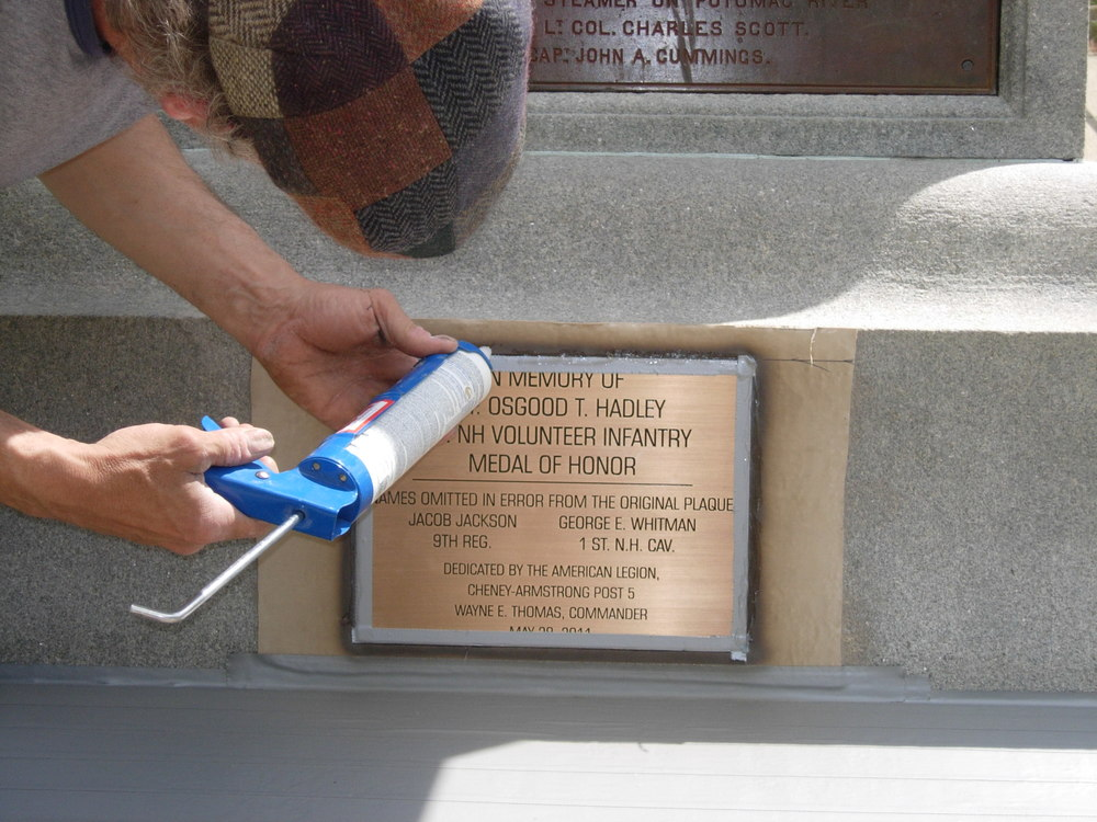 Finish caulking to seal the edges of the plaque