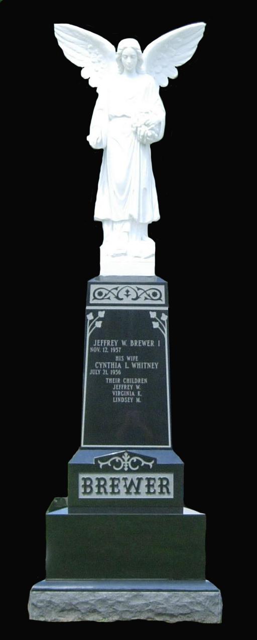 Italian Marble hand carved statue atop Jet Black obelisk