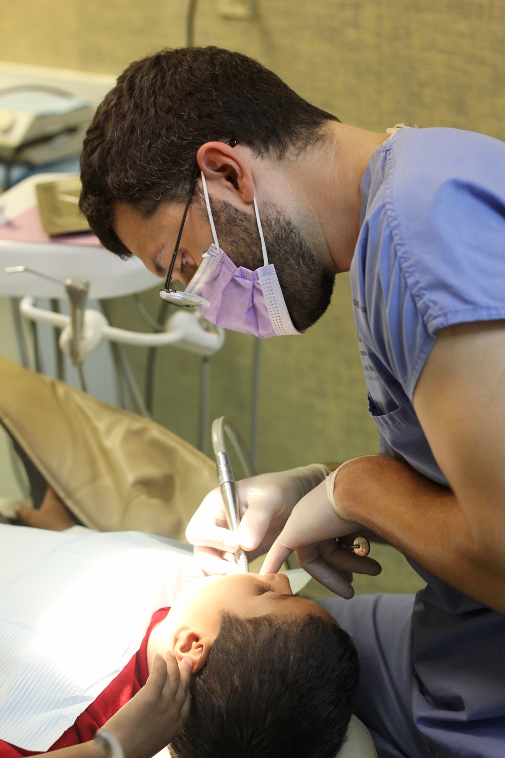 Dr. Ryan Colosi working on teeth.