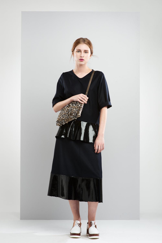 ManleyAW17 - Sadie Patent Jumper - Black €250. Sadie Maxi Patent Skirt - Black €250. Aubree Bag - Silver & Gold €230 HR 2.jpg