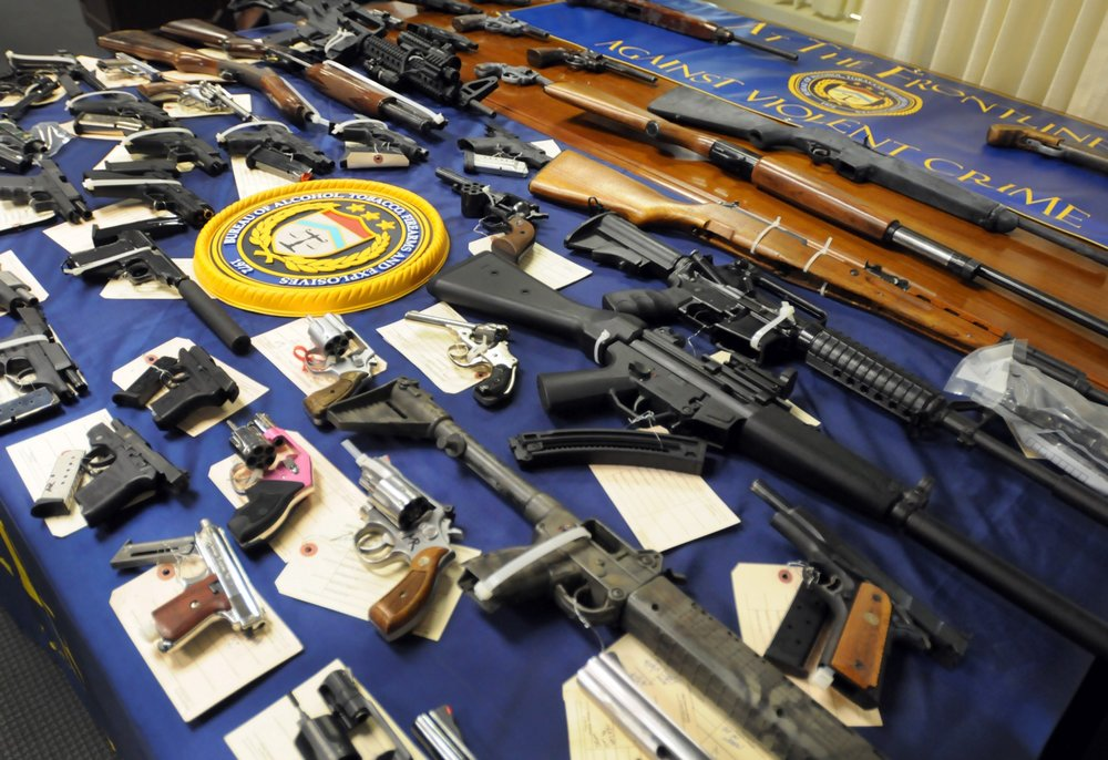 Some of the guns seized by the NYPD last year. Photo credit: AP