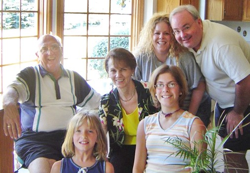 Stephanie Austin (top, second from right) relinquished her daughter Maggie (below her), then reconnected with her and the girl's adoptive family.