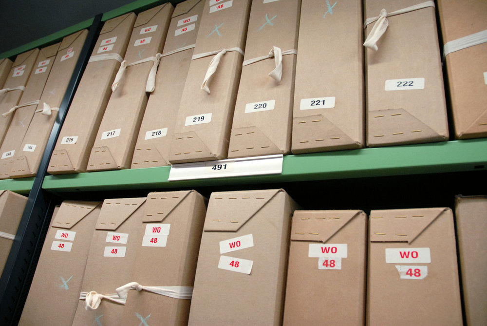 Boxes_of_documents_on_repository_shelving_at_The_National_Archives.jpg