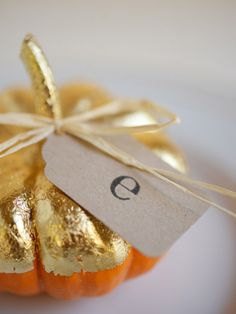 One of my favorite simple, DIY ideas - hand-dipped gold pumpkin place cards