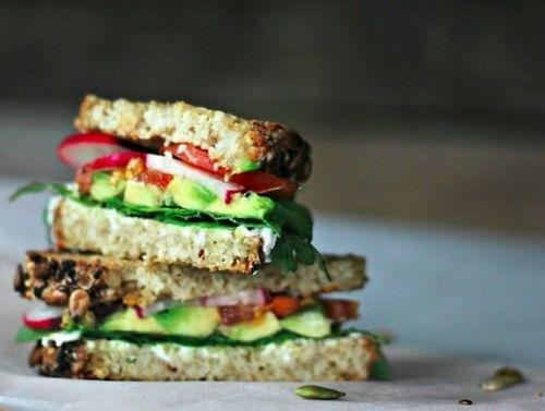Avocado, tomato, lettuce and radishes on wholegrain bread.