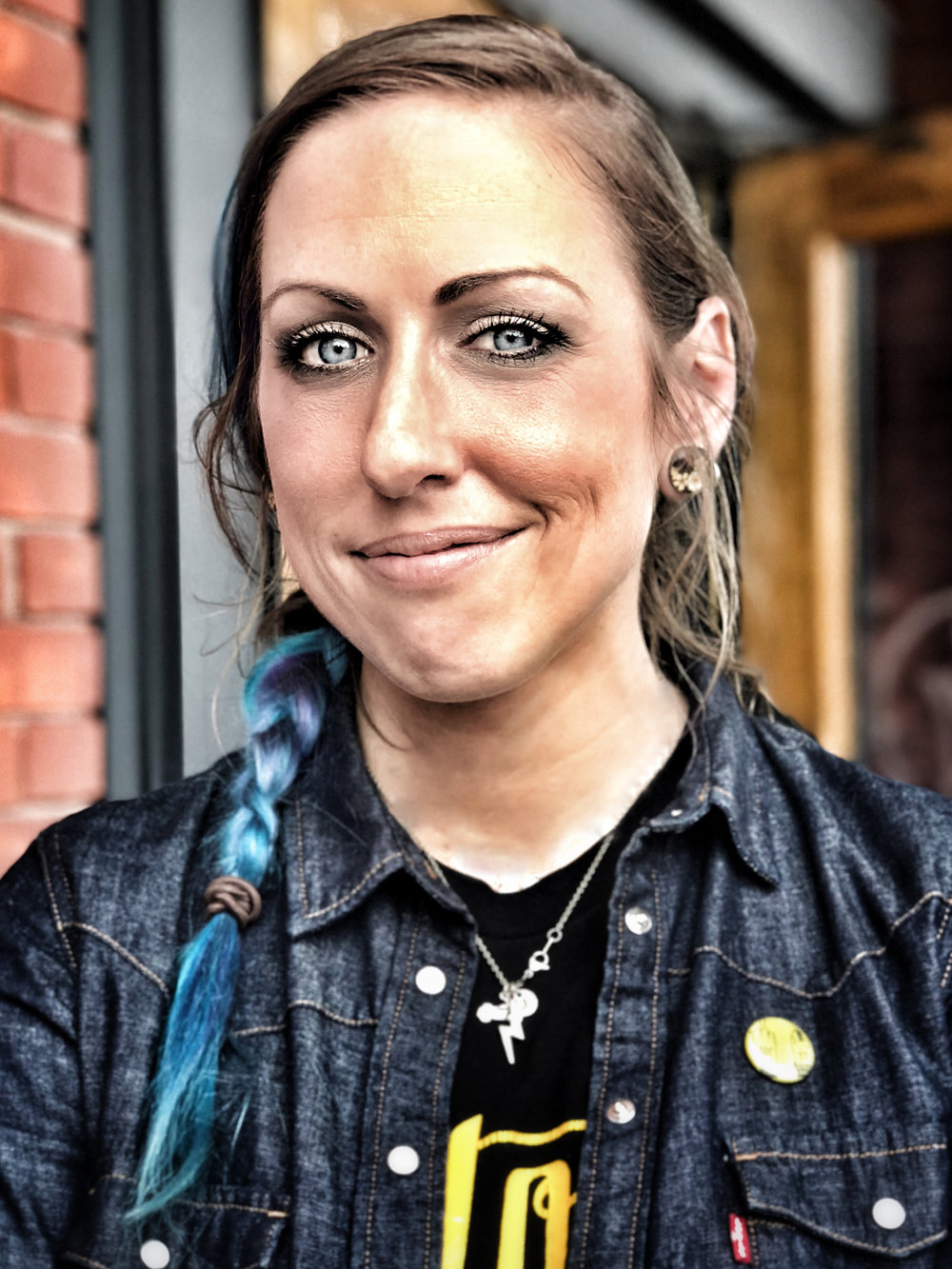 Jen Sikes: She lives in Minneapolis and rides an Iron 883. She rides with the twin city Lita's.