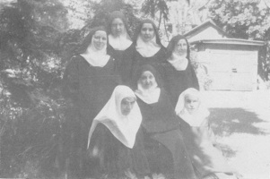 Back: Sisters Mary (Roman), Margaret Mary (Champney), Teresa (Connolly), Imelda (Nichols)  Front: ___, Mother Aloyisius (Rogers) Sister Emmanuel (Sache)