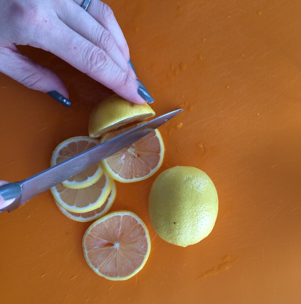 Wash lemons and slice thinly, removing the seeds as you go.