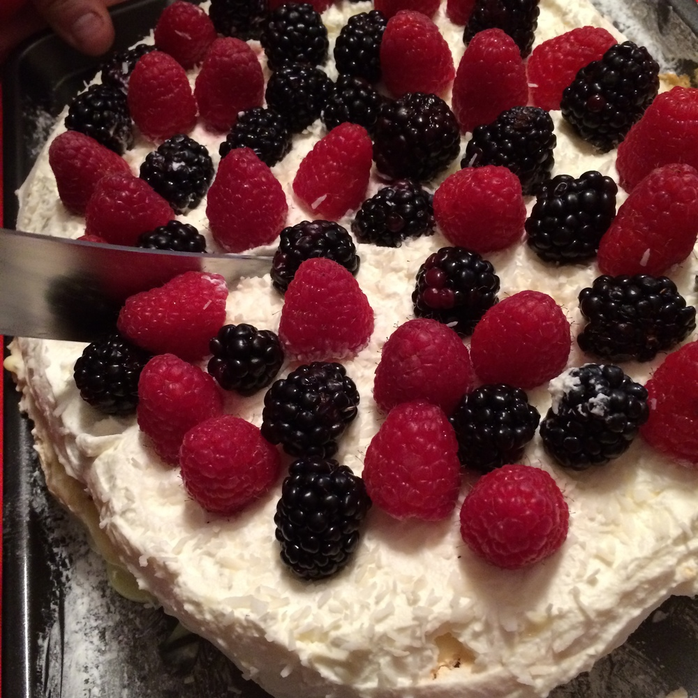 Topped with whipped cream, Italian custard and fresh berries...