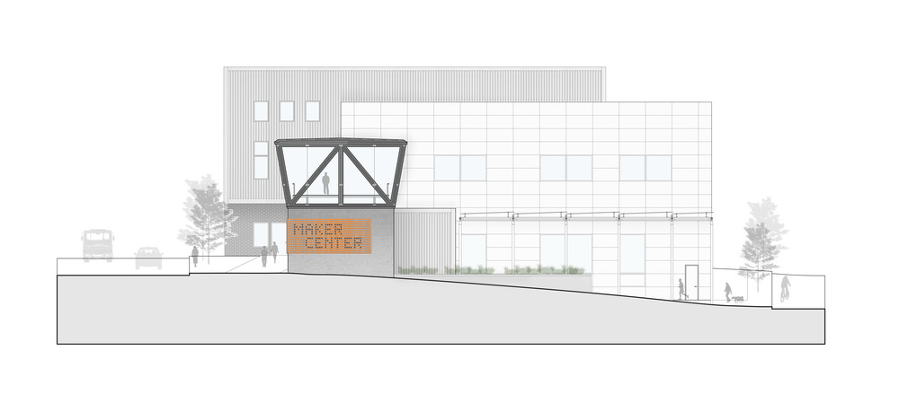 West Elevation of the Maker Center showing the grade change from street level and the deployable roof struture