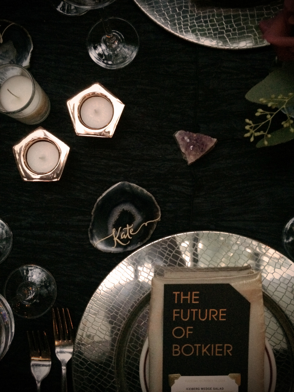 Agate coasters with handwritten names were used as place cards for each VIP guest. Amethyst clusters and rose gold geometric votive holders added to the texture of a luxurious evening out.