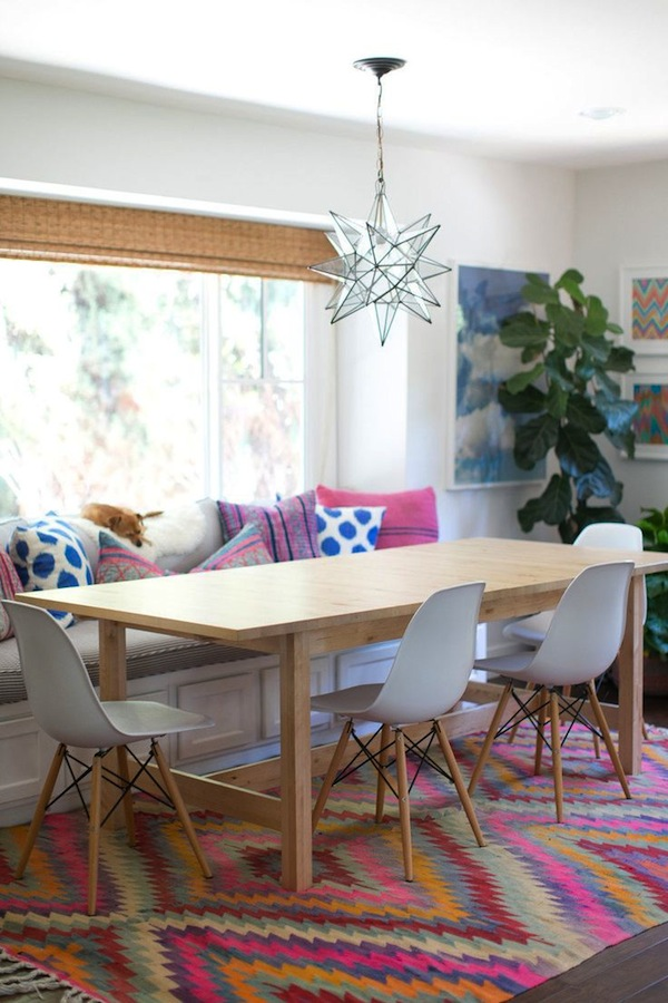 Amber Lewis' design | Amber Interiors    Amber makes design that is swoon worthy...it's cozy, modern, bohemian, colorful, playful, and sophisticated all wrapped up in a perfect package. The modern chairs, balance of patterns on the settee, and fiddle leaf in the corner (not to mention that natural light!) make for a yummy dining area.