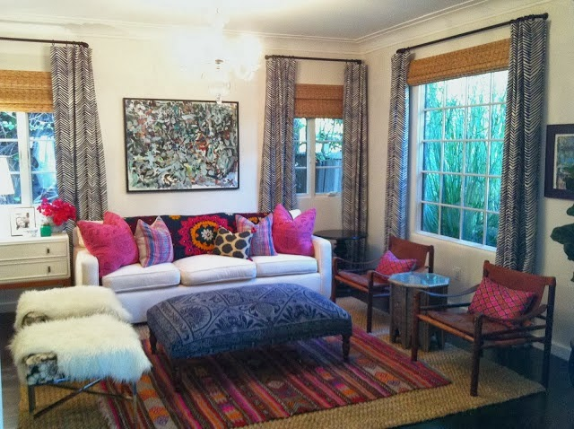 Amber Interiors    Proof that pink can mix well with just about anything. I love the bold layering of patterns and the play of the warm pink and seagrass against the cool blue. This room is luscious.