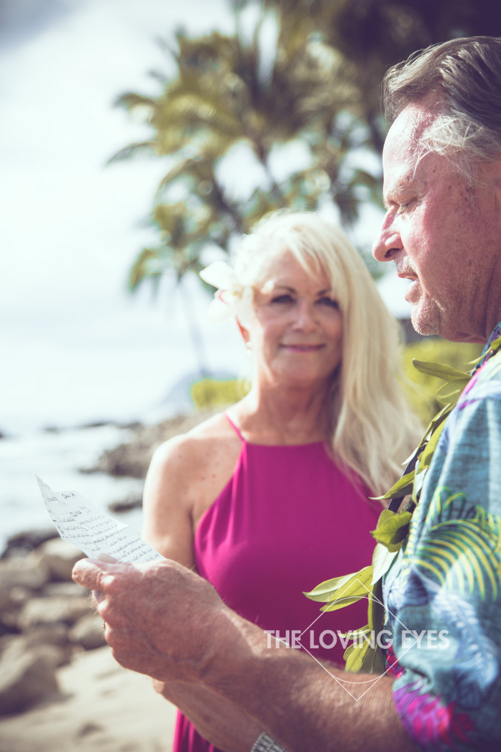 Reading vows at vow renewal ceremony on the beach at Ko Olina Four Seasons Lagoon
