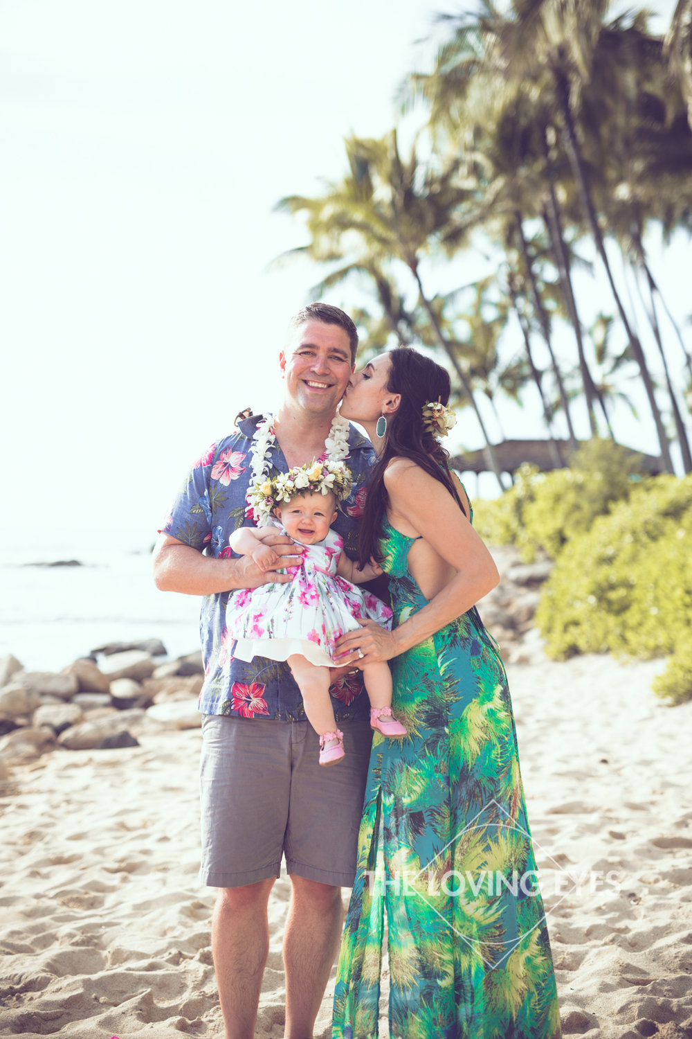 Family portrait on the beach at Ko Olina Four Seasons Lagoon