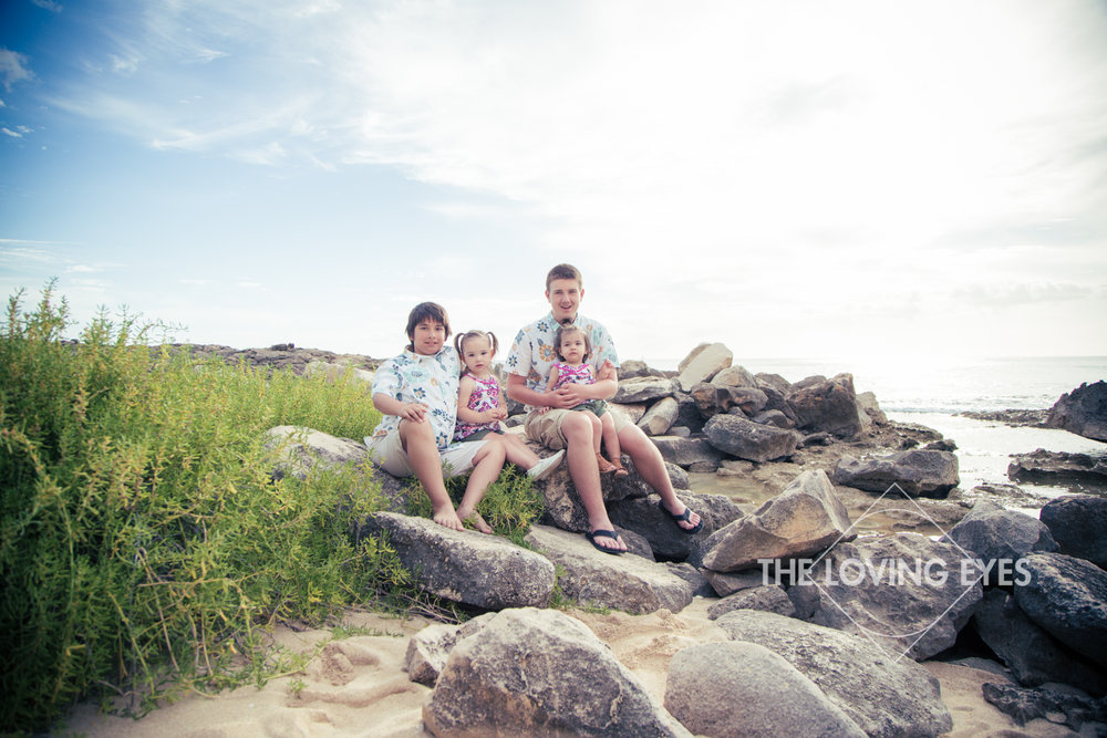 Family vacation photography of children on the beach at Ko Olina Four Seasons Lagoon