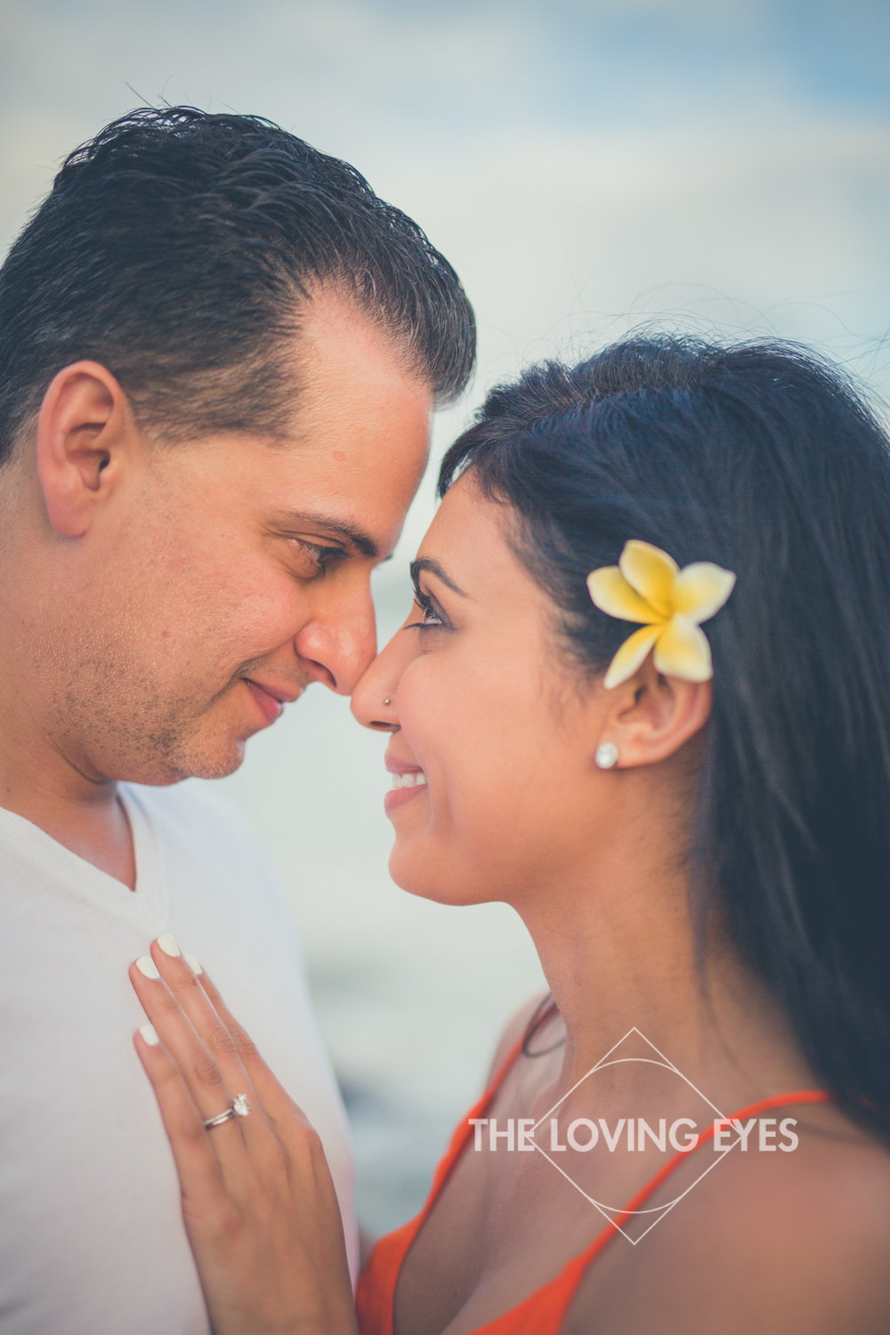Looking into each other's eyes on the beach at Ala Moana Beach Park