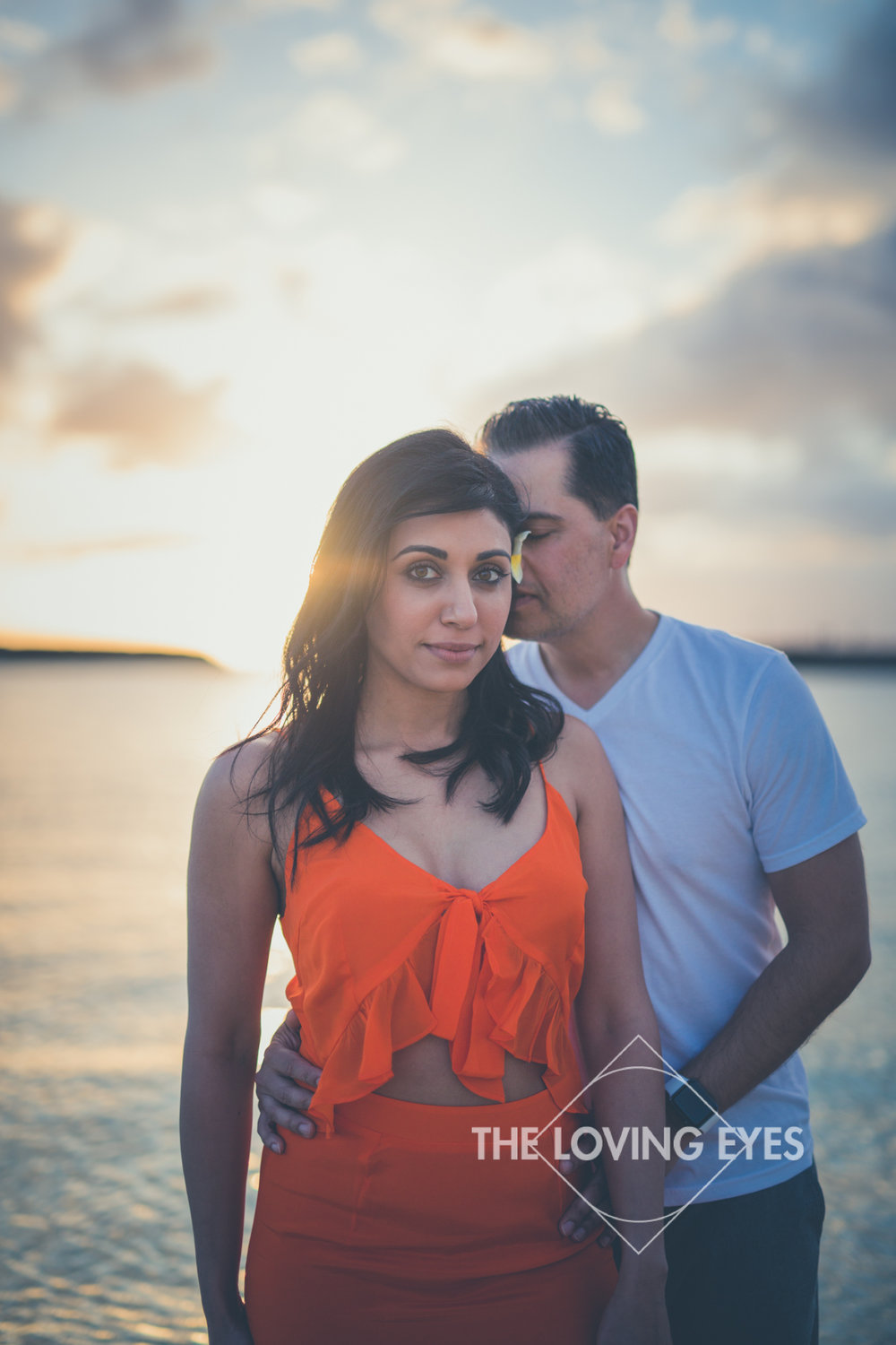 Romantic couple photograph on the beach during sunset at Ala Moana Beach Park