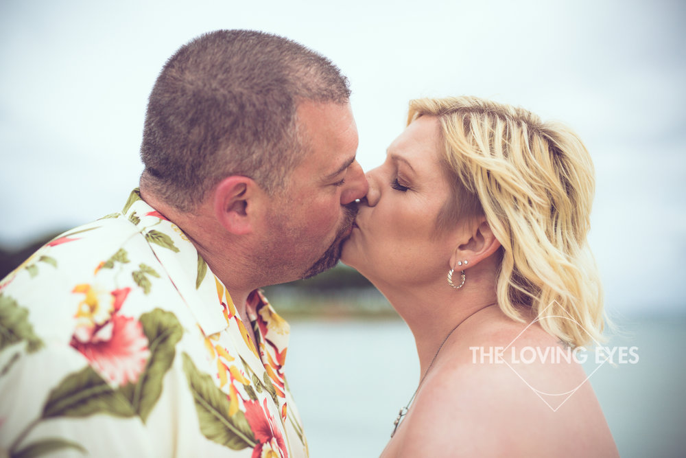 Kissing on the beach during Hawaii vacation at Ala Moana Beach Park