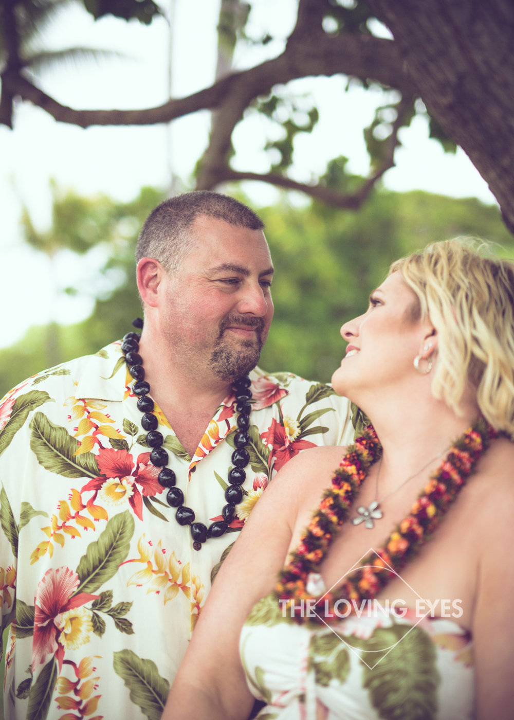 Couple portrait on the beach during Hawaii vacation at Ala Moana Beach Park