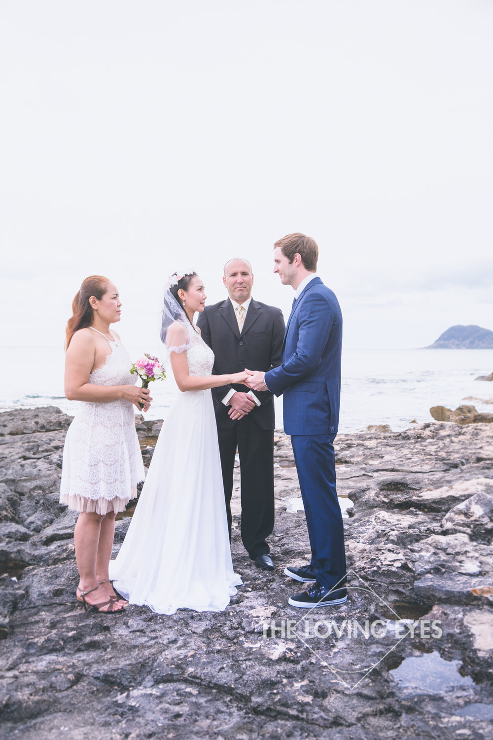 Intimate wedding ceremony at the lagoon near the Four Seasons Resort at Ko Olina