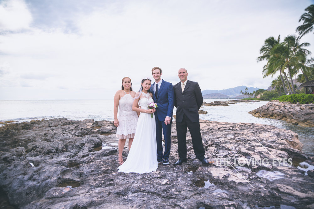 Family photos with the bride and groom at the lagoon near the Four Seasons Resort at Ko Olina