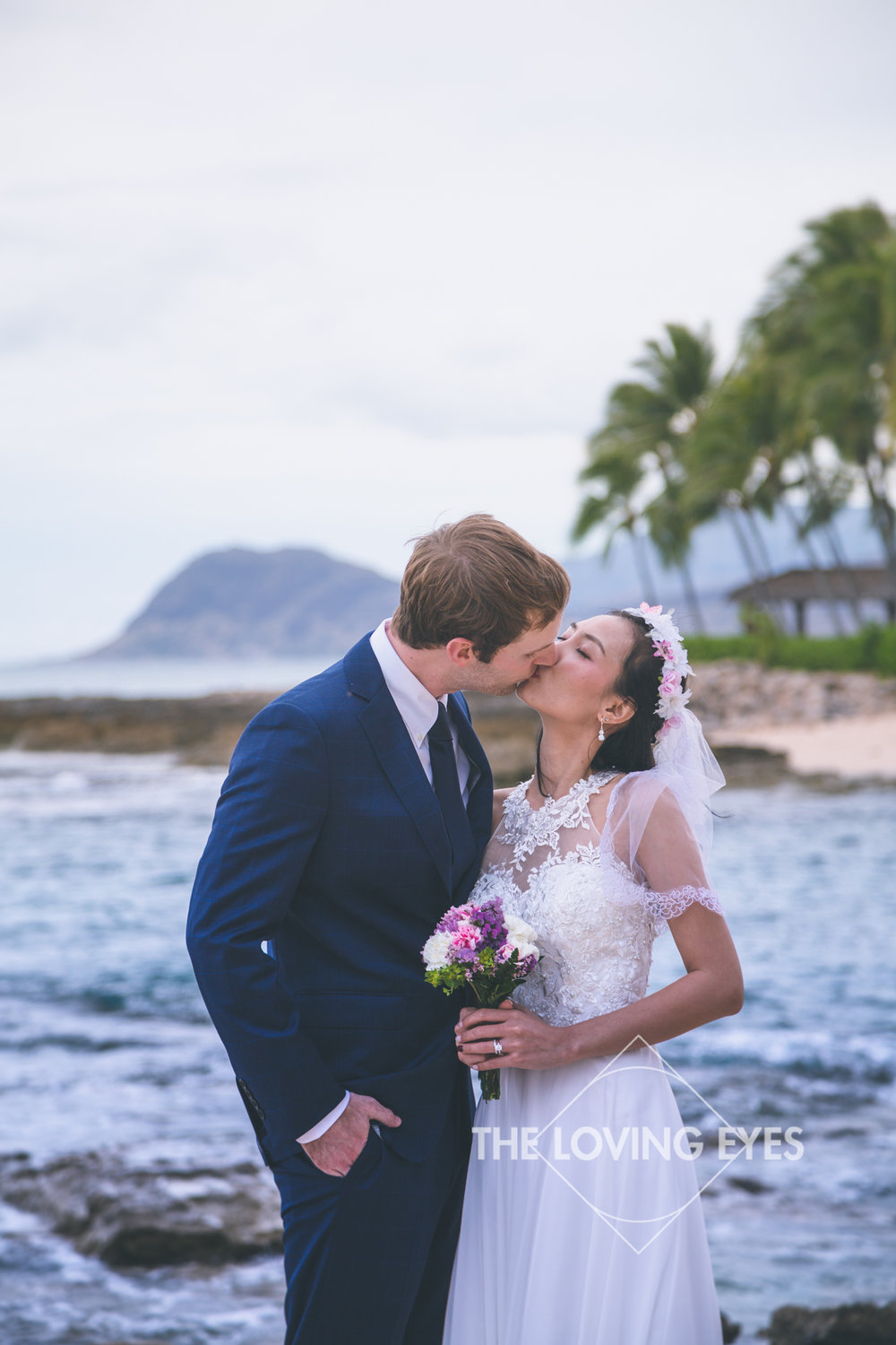An intimate moment on the beach at the lagoon near the Four Seasons Resort at Ko Olina