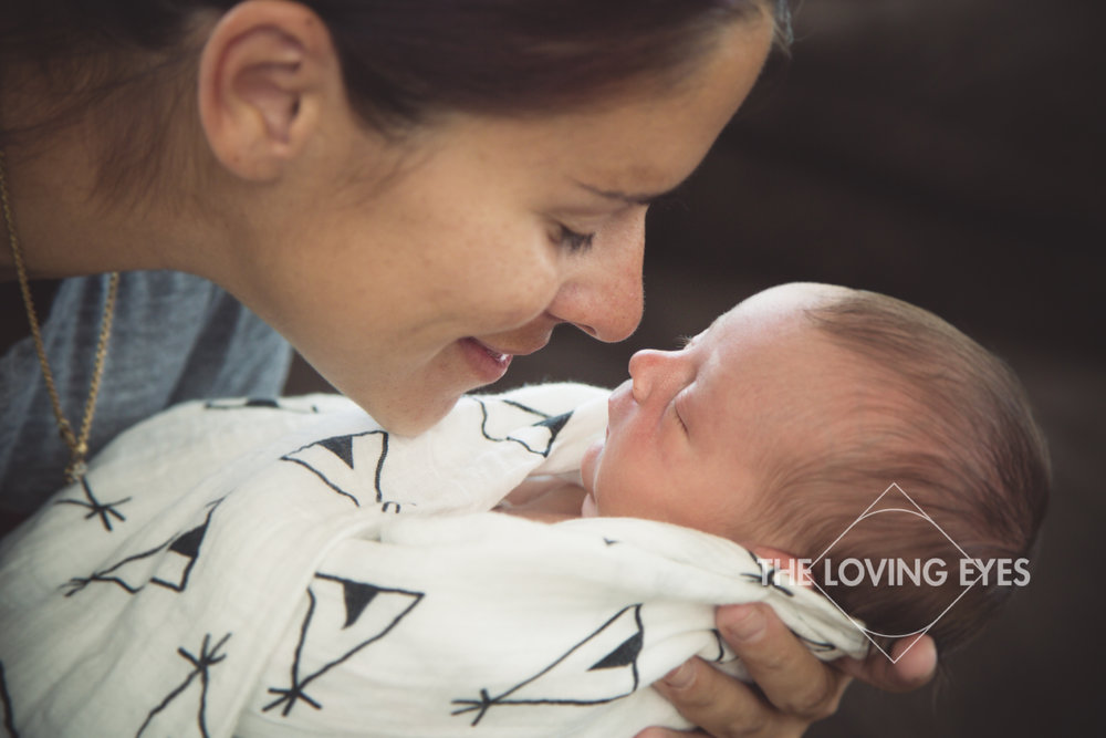 Hawaii newborn photography of intimate moment between mother and baby son
