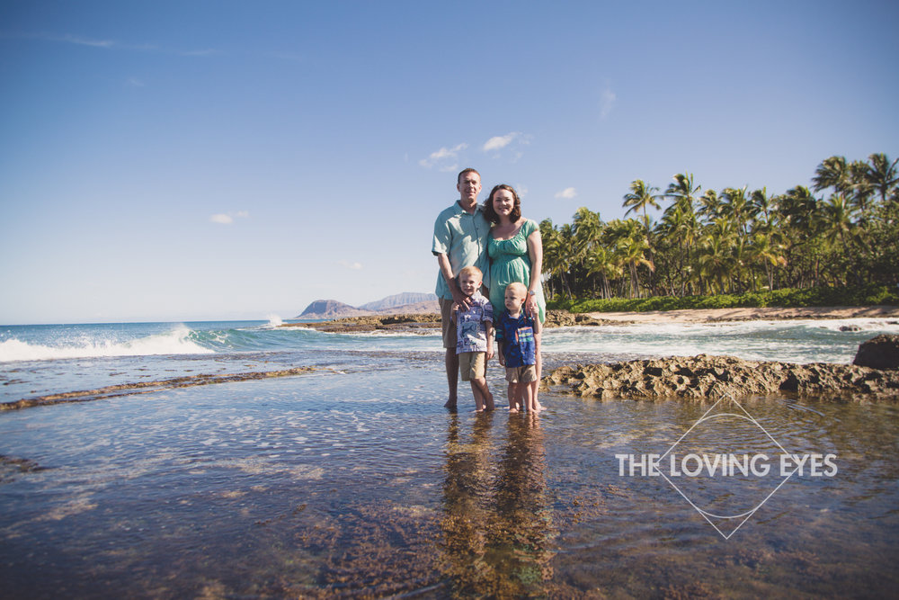 Hawaii family portrait on a tide pool at the beach in Ko Olina