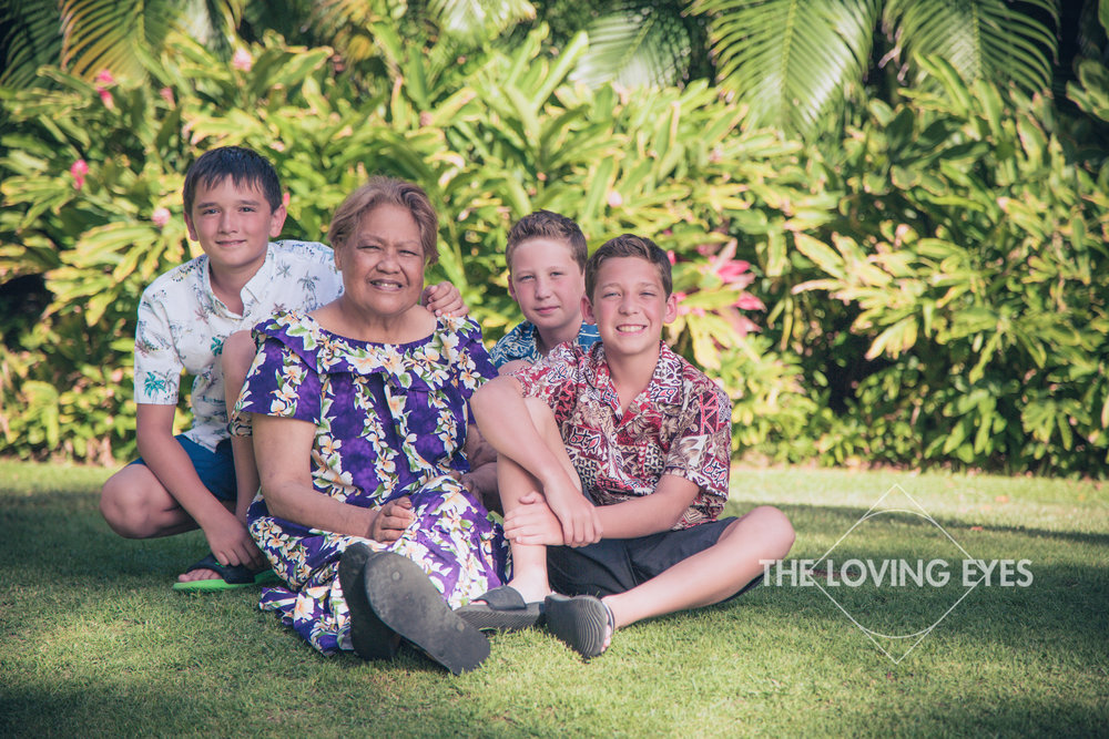 Grandma and grandchildren portrait during Hawaii vacation in the garden at the Hilton Hawaiian Village