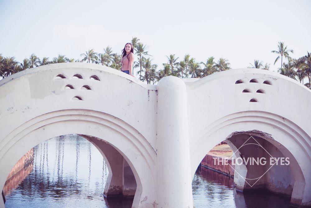Senior portrait on a bridge at Ala Moana Beach Park in Hawaii