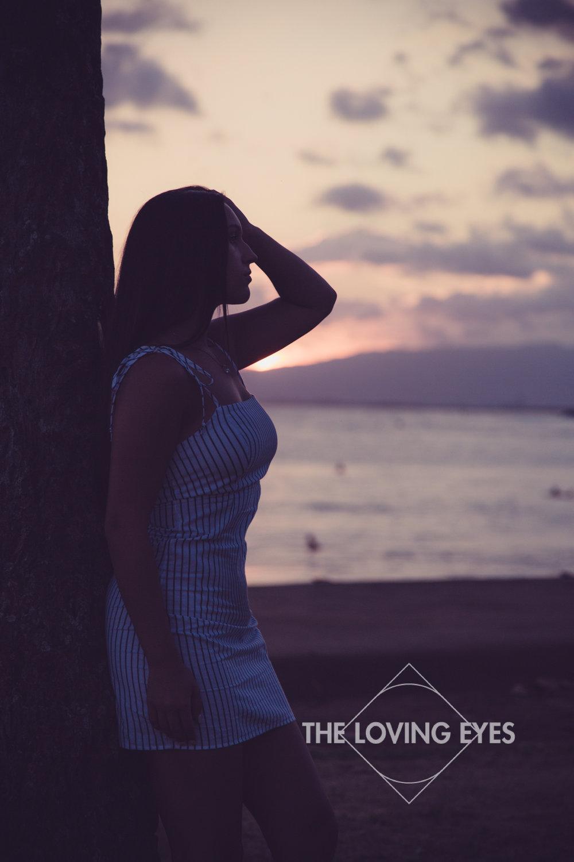 Silhouette senior portrait during sunset on the beach at Ala Moana Beach Park in Hawaii
