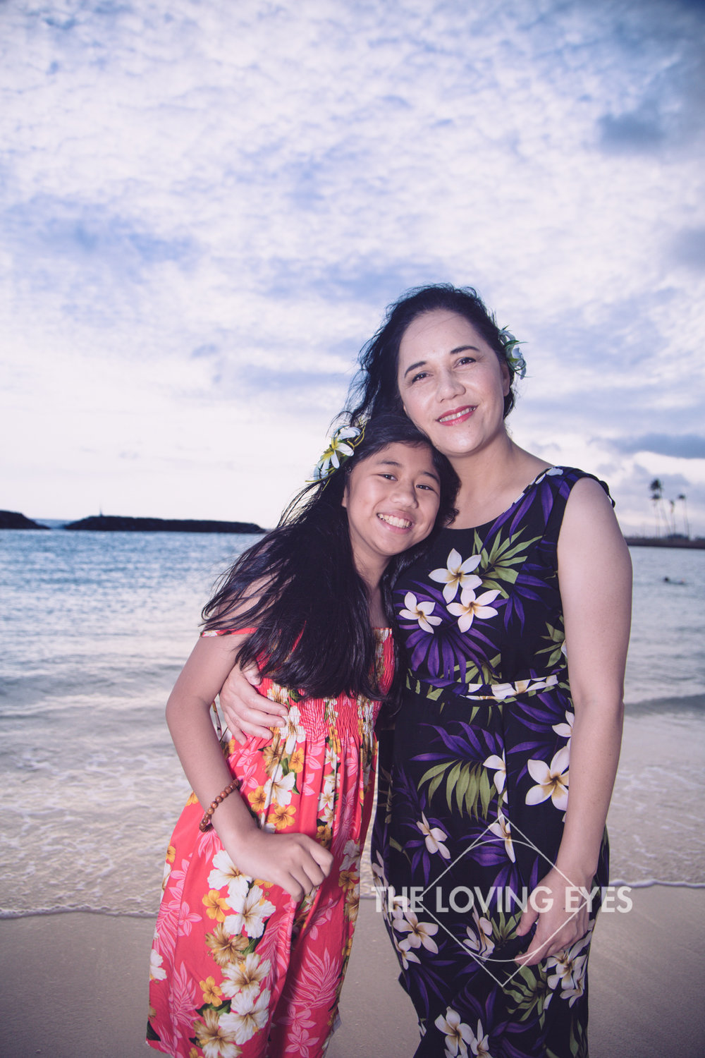 Mother and daughter portrait on the beach at Ala Moana Beach Park in Hawaii