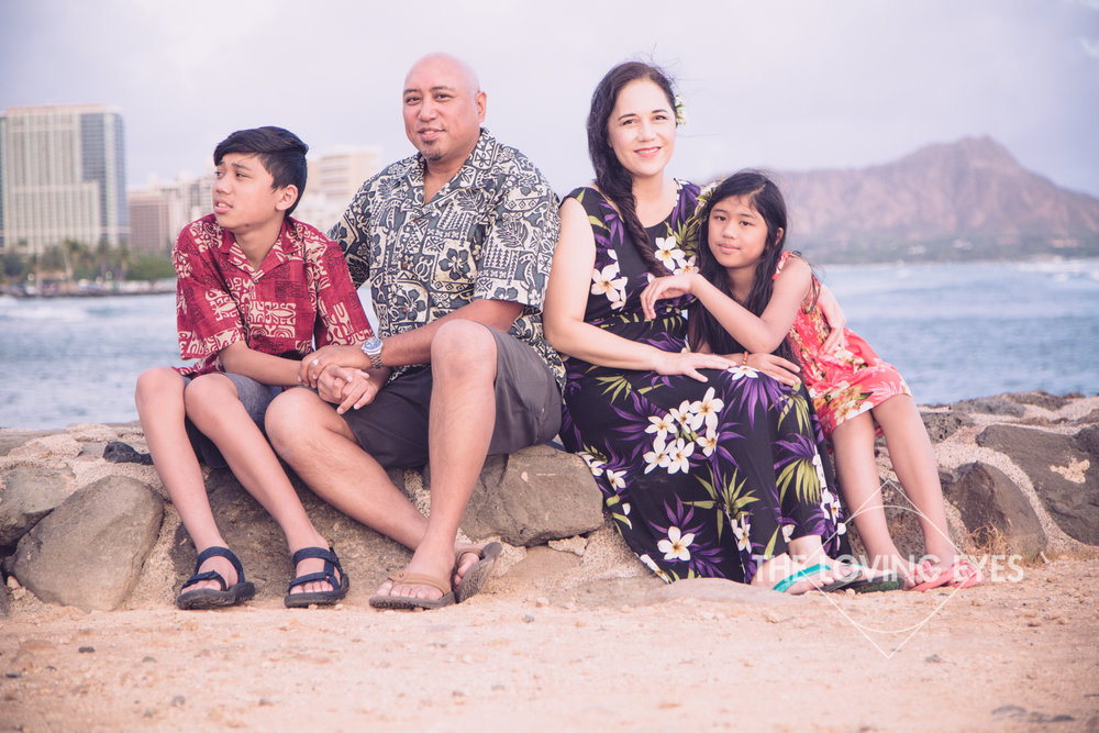 Family vacation portrait on the beach with Diamond Head at Ala Moana Beach Park in Hawaii