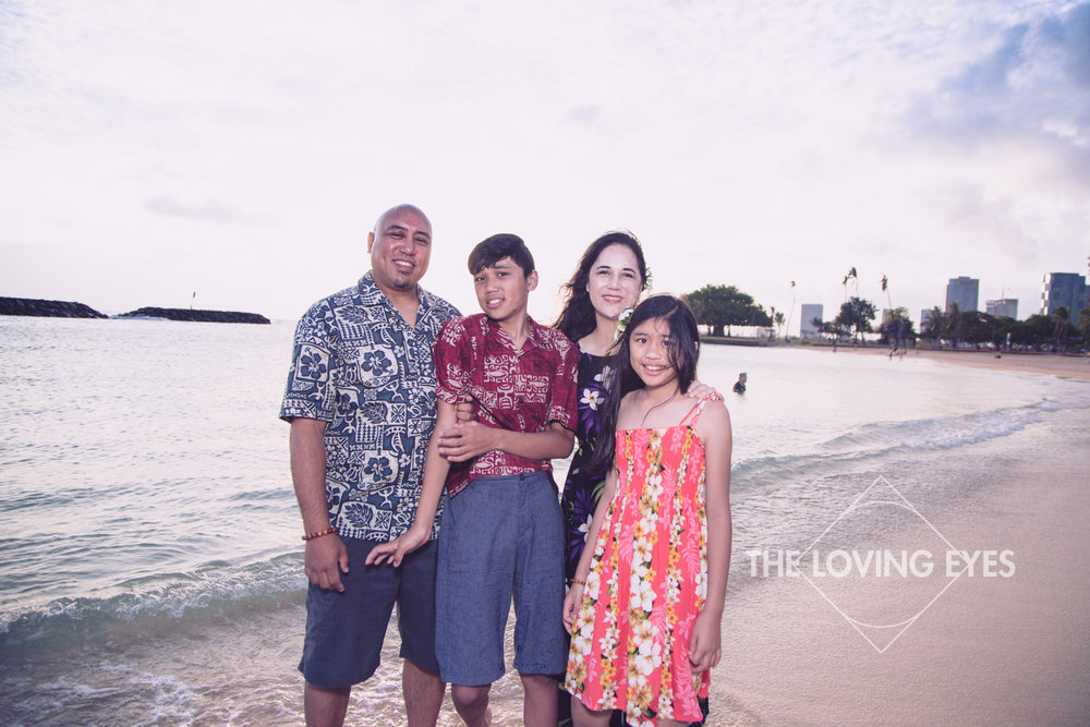 Family vacation portrait on the beach at Ala Moana Beach Park in Hawaii