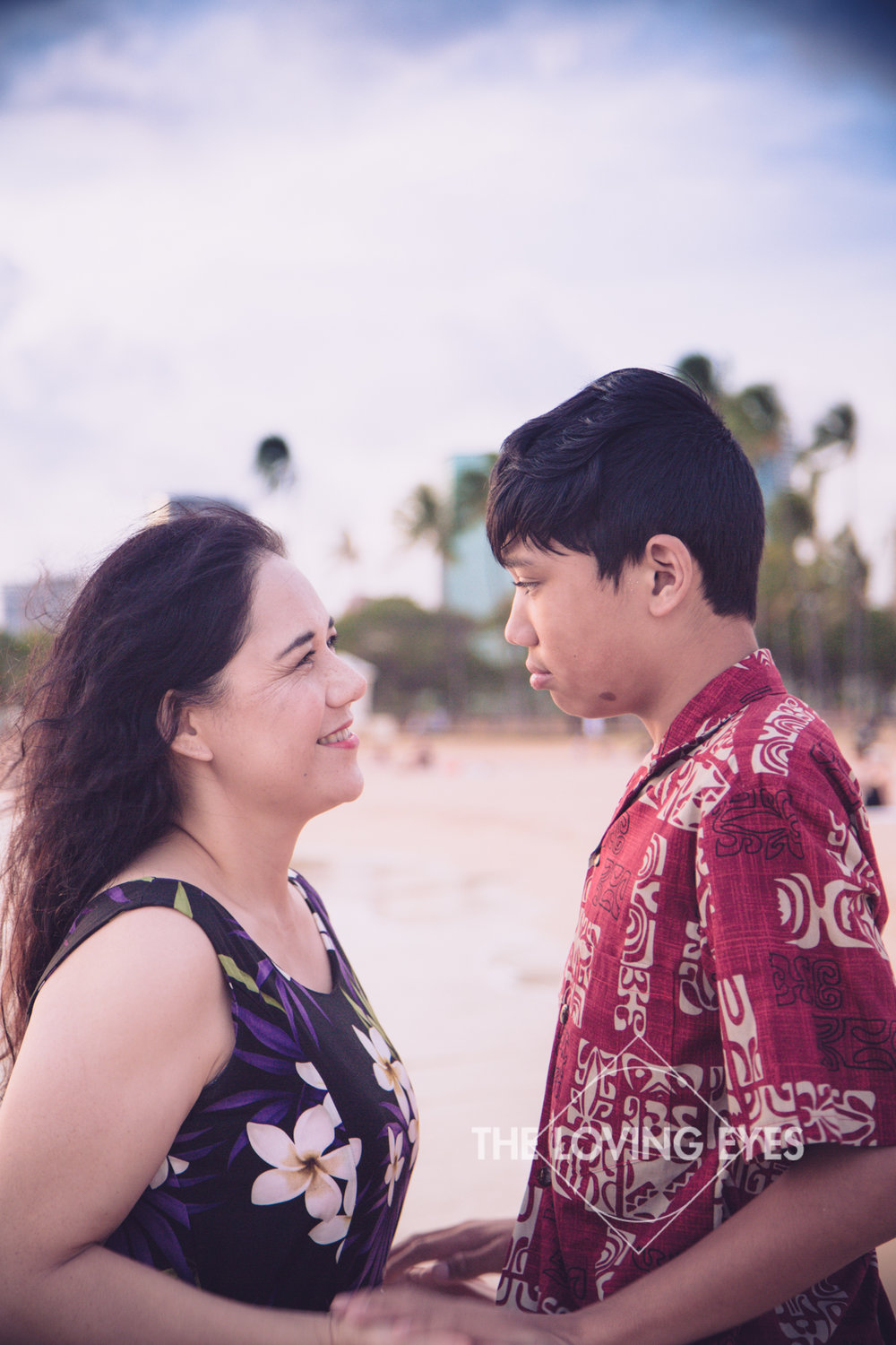 Mother and son portrait on the beach at Ala Moana Beach Park in Hawaii
