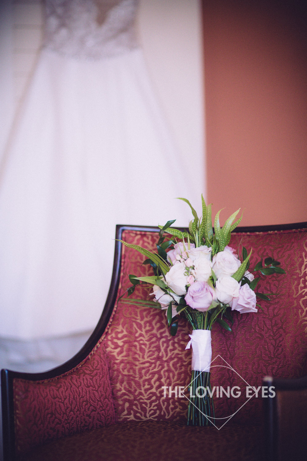 Wedding dress and bridal bouquet in bridal suite
