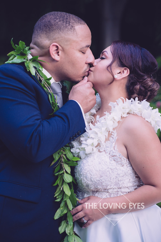 Bride and Groom kiss on wedding day at Hilton Hawaiian Village Rainbow Suite in Waikiki