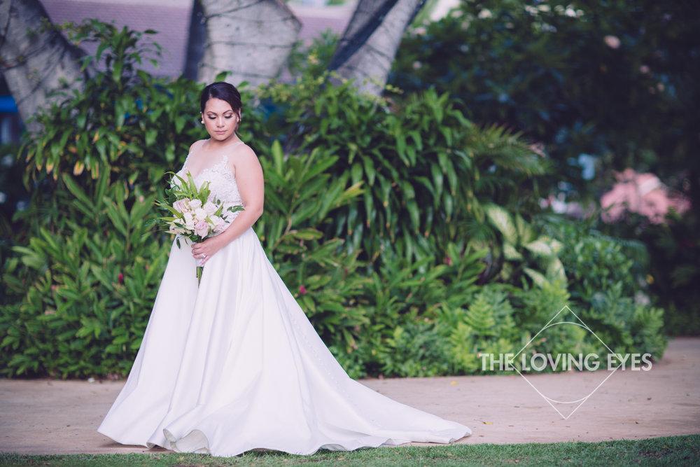 Elegant bridal portrait with tropical Hawaiian wedding bouquet on wedding day at Hilton Hawaiian Village Rainbow Suite in Waikiki