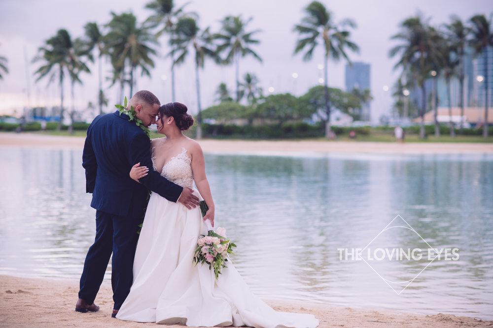 Bride and Groom on wedding day on Waikiki Beach
